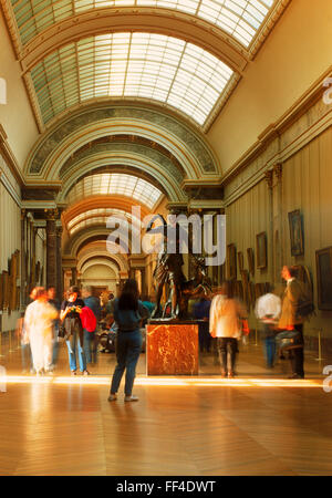 People at Louvre Museum in Denon Section with Greek and Roman antiquities in Paris - Stock Image