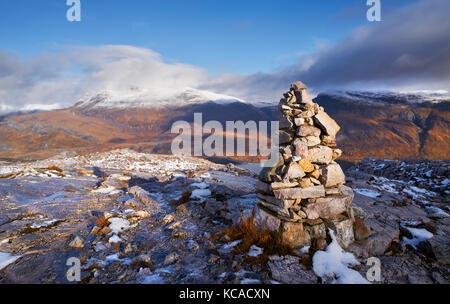 A mountain Cairn on Beinn Eighe with the summits of Slioch and Beinn a Mhuinidh in the distance. Scottish Highlands, - Stock Image