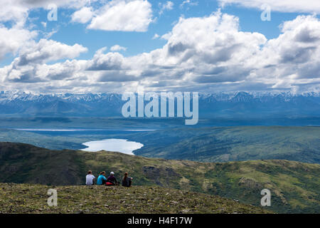 People looking out over Denali National Park, Alaska - Stock Image
