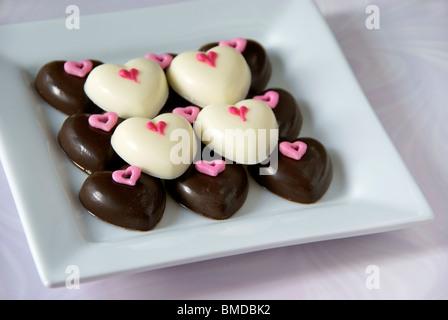 Heart shaped chocolates - Stock Image