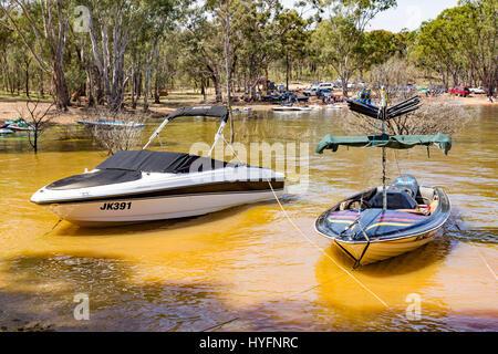 Waterski boats tied up on Lake Eppalock, near Bendigo, Victoria, Australia - Stock Image
