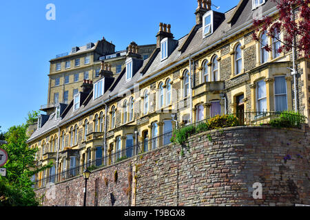 Bristol Victorian era row of terraced properties in Clifton on hill above Hotwells with bay windows, curved sash windows, dormers, The Paragon behind - Stock Image