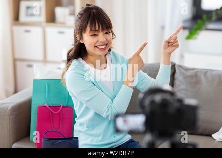 female blogger making video blog about shopping - Stock Image