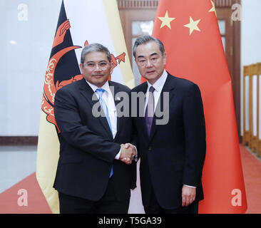 Beijing, China. 24th Apr, 2019. Chinese State Councilor and Foreign Minister Wang Yi (R) meets with Brunei's Second Minister of Foreign Affairs and Trade Dato Paduka Haji Erywan bin Pehin Yusof in Beijing, capital of China, April 24, 2019. Credit: Liu Bin/Xinhua/Alamy Live News - Stock Image