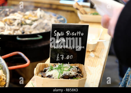 A food stall selling spelt risotto with wild mushrooms at Borough Market in London England UK  KATHY DEWITT - Stock Image