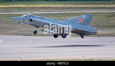 Vintage Saab J-35 Draken jet fighter taking off for a display flight at the 100 Years Anniversary Air Show of the Finnish Air Force at Tikkakoski. - Stock Image