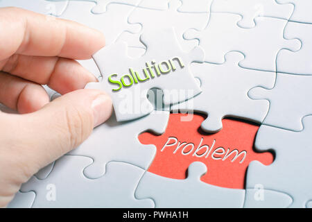 The Words Solution And Problem In Missing Piece Jigsaw Puzzle - Stock Image