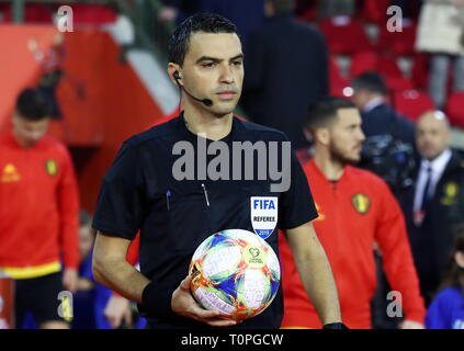 Brussels, Belgium. 21st Mar, 2019. BRUSSELS, BELGIUM - MARCH 21, 2019: Referee Ovidiu Hatega carries an official matchball ahead of the UEFA Euro 2020 qualifying football game between Belgium and Russia at King Baudouin Stadium. Anton Novoderezhkin/TASS Credit: ITAR-TASS News Agency/Alamy Live News - Stock Image