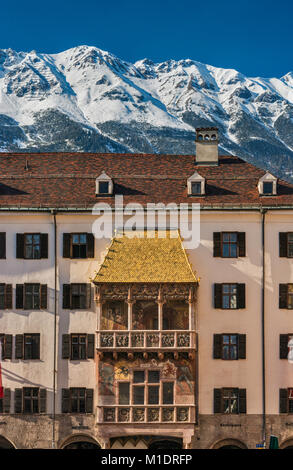Golden Roof (Goldenes Dachl) building, dated 1500, Nordkette massif in distance, Old Town in Innsbruck, Tyrol, Austria - Stock Image