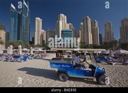 Beach Butler at Hotel Beach of Hilton in Dubai , United Arab Emirates - Stock Image