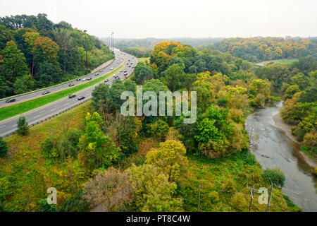 Don Valley Parkway (a.k.a. D.V.P.) and Lower Don River in autumn rain in Toronto, Ontario, Canada - Stock Image