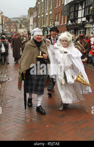 Rochester, Kent, UK. 1st December 2018: A couple dressed as charachters from the Dickensian Age particiapte in the main parade on Rochester High Street. Hundreds of people attended the Dickensian Festival in Rochester on 1 December 2018. The festival's main parade has participants in Victorian period costume from the Dickensian age. The town and area was the setting of many of Charles Dickens novels and is the setting to two annual festivals in his honor. Photos: David Mbiyu/ Alamy Live News - Stock Image
