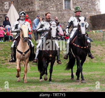 Three Knights in full Armour demonstrating their  Horse riding skills, during an  English Heritage Jousting Tournament at Dover Castle,  August 201 - Stock Image