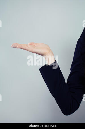 Business woman hand with empty open palm on white background - Stock Image