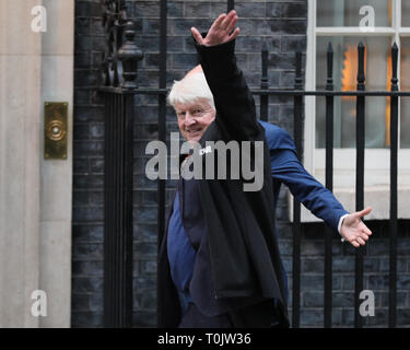 Downing Street, London, UK. 20th Mar, 2019. Stanley Johnson, author and former politician, and father of Boris Johnson, MP and Jo Johnson, MP, enters Downing Street for an evening function, waving at photographers. Credit: Imageplotter/Alamy Live News - Stock Image