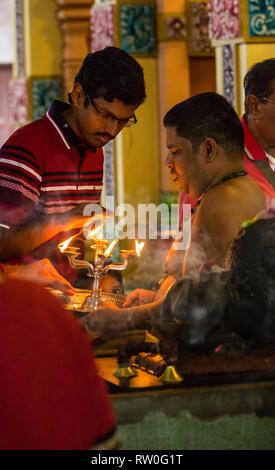 Hindu Priest and Worshipers, Sri Mahamariamman Hindu Temple, Kuala Lumpur, Malaysia. - Stock Image