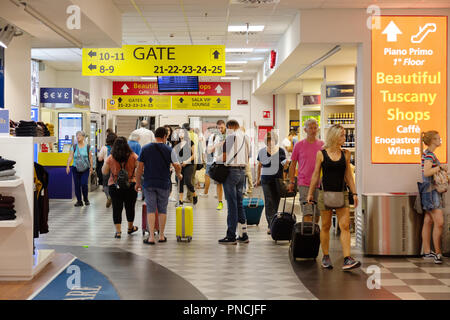 People in departures going to the gate , the terminal interior, Pisa International Airport, Pisa, Tuscany, Italy Europe - Stock Image
