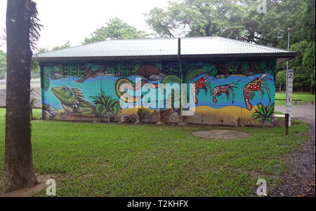 Public toilet block painted by local Indigenous artists featuring rainforest and river animals, Mossman, Queensland, Australia - Stock Image
