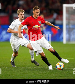 Optus Stadium, Burswood, Perth, W Australia. 17th July 2019. Manchester United versus Leeds United; pre-season tour; Nemanja Matic of Manchester United controls the ball in front of Patrick Bamford of Leeds United Credit: Action Plus Sports Images/Alamy Live News - Stock Image