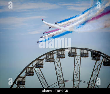 GB - DEVON: RAF Red Arrows Display Team at the Torbay Airshow flying over English Riviera Wheel at Torquay (31. May 2019) - Stock Image