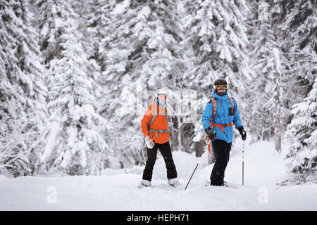 Skier snowboarder posing on forest backdrop. Off-piste freeride ski resort Sheregesh - Stock Image