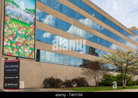 ASHEVILLE, NC, USA-4/11/19: The Biltmore Corporate office building, in early spring, with a mural of Biltmore House. - Stock Image