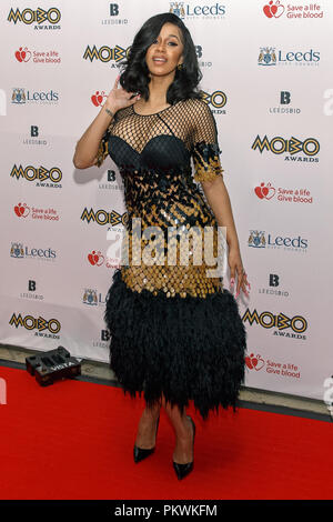 Cardi B poses for photographers on the red carpet at the MOBO Awards. Cardi B is an American rapper, singer and celebrity born Belcalis Marlenis Almanzar in 1992. Full length, whole body, portrait orientation. - Stock Image