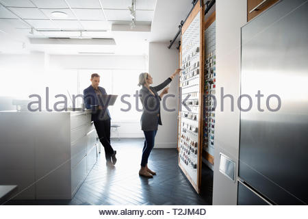 Interior designers looking at swatches in design studio - Stock Image