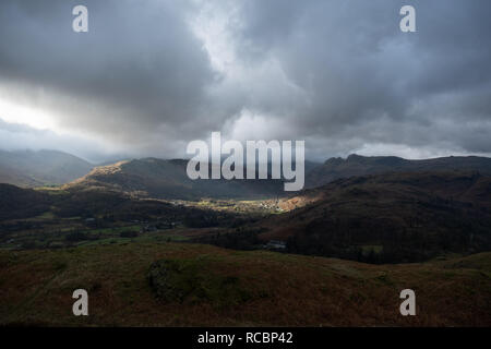 Cumbria UK. 15th January 2019. UK weather. Sunlight illuminates the village of Chapel Stile in the Langdale Valley. Colder weather will arrive by the end of the week. Credit: Mark Hunter/Alamy Live News - Stock Image