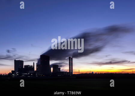 Brown coal power plant of the company RWE Power in Niederaussem at evening - Stock Image