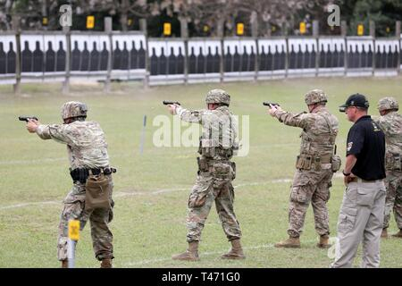 U.S. Army Sgt. 1st Class Sean Watson, a Bath, New York native who is an instructor with the U.S. Army Marksmanship Unit, watches over the competitors at the U.S. Army Small Arms Championships at Fort Benning, Georgia March 10-16, 2019. The annual, week-long competition that is hosted by the U.S. Army Marksmanship Unit is the Army's premier marksmanship competition that tests Soldiers on both their primary and secondary weapons through 11 different courses of fire. - Stock Image