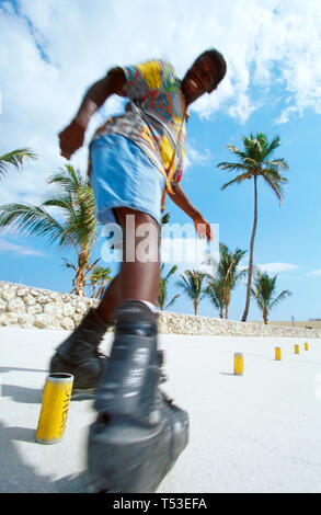 Miami Beach Florida South Beach Black male rollerblades backwards obstacle course - Stock Image