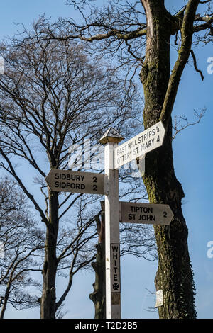 Signpost at White Cross, where the East Devon Way meets East Hill Strips, near Ottery St Mary, Devon - Stock Image