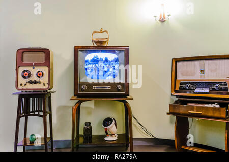 Reel to Reel player, black and white television and an old medium/long wave radio in a living room from the 1950s. - Stock Image