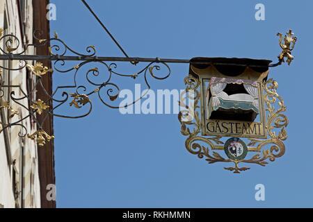 Wrought-iron hanging shop sign, guest office, Wangen, Allgäu, Baden-Württemberg, Germany - Stock Image