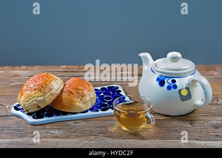 Studio shot of pastries and tea on a table - Stock Image