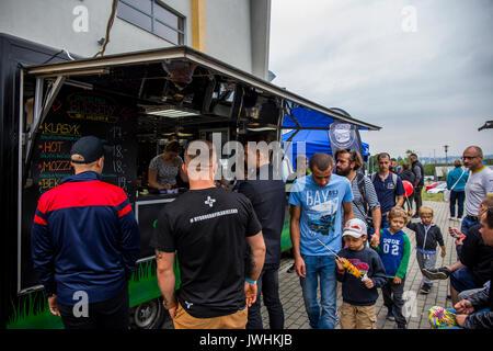 Bielsko-Biala, Poland. 12th Aug, 2017. International automotive trade fairs - MotoShow Bielsko-Biala. People walking. Credit: Lukasz Obermann/Alamy Live News - Stock Image