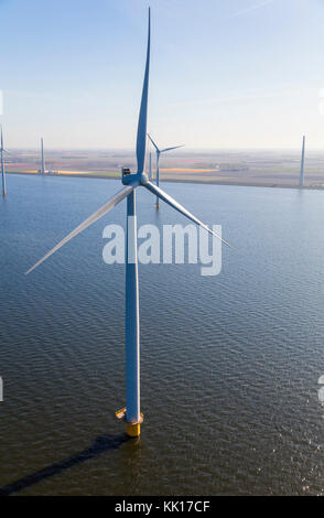 Aerial view of wind turbines at sea, North Holland, Netherlands - Stock Image