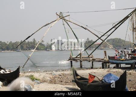 Chinese fishing nets in Fort Kochi Beach Kerala - Stock Image