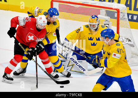 Bratislava, Slovakia. 18th May, 2019. From left hockey player Switzerland SIMON MOSER and GABRIEL LANDEDSKOG, goalie HENRIK LUNDQVIST, ELIAS PETTERSSON all of Sweden in action during the match Sweden against Switzerland within the 2019 IIHF World Championship in Bratislava, Slovakia, on May 18, 2019. Credit: Vit Simanek/CTK Photo/Alamy Live News - Stock Image