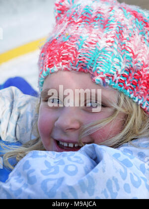 Happy young skier in the ski resort of moraine, France - Stock Image