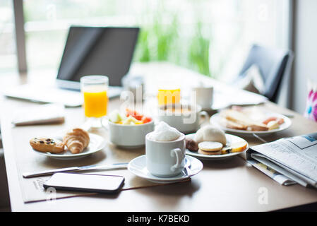 Coffee and breakfast on cafe table - Stock Image