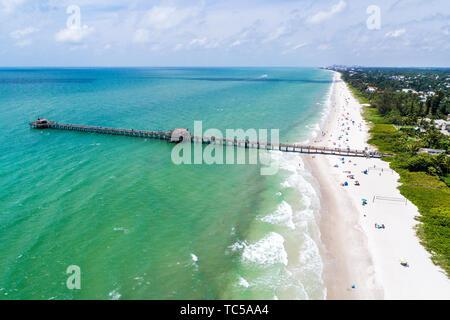 Naples Florida Gulf of Mexico Historic Pier public beach aerial overhead bird's eye view above - Stock Image