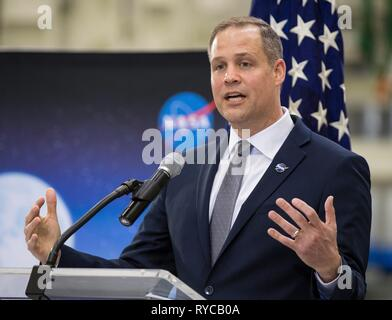 NASA Administrator Jim Bridenstine addresses employees on progress toward sending astronauts to the Moon and on to Mars during a televised event at the Kennedy Space Center March 11, 2019 in Cape Canaveral, Florida. Representatives from the Kennedy workforce, news media, and social media were in attendance. NASA's Orion spacecraft, which is scheduled to be flown on Exploration Mission-2, was on display. For information on NASA's Moon to Mars plans, visit: www.nasa.gov/moontomars Photo credit: (NASA/) - Stock Image