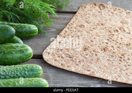 Pitta bread with green-stuff vegatables during summer barbecue with copyspace. Concept of healthy food outdoors - Stock Image