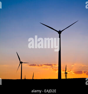 Windmills with sunset, evening dark sky with clouds - Stock Image