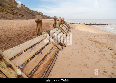 view of breakwaters on the north norfolk coast at overstrand - Stock Image