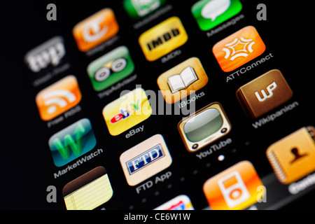Muenster, Germany, January 26, 2012: Image of the iphone touch screen. Display shows a collection of useful apps - Stock Image