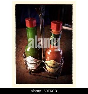 Two bottles of red and green Tabasco sauce - Stock Image