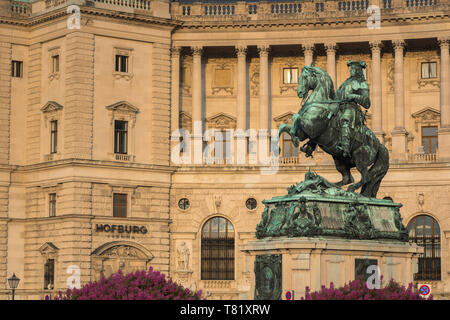 Vienna Austria, view of the statue of Prince Eugene of Savoy against the backdrop of the Neue Burg building in the Hofburg Palace complex, Austria. - Stock Image